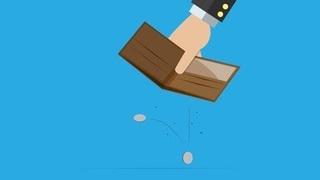 折りたたみの財布から小銭が落ちている画像.jpg