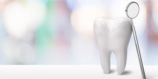 歯と拡大鏡の画像.jpg